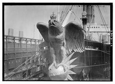 Photo shows the figurehead of the S.S. Imperator, an ocean liner of the Hamburg America Line. The figurehead was damaged in 1914 and replaced with grillwork.