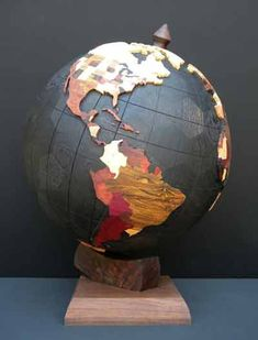 World Globe 2012 by Steve Garrison. Thirty different hardwoods make up the states and countries. Base sphere representing oceans is a geodesic sphere of ebonized red oak. World Globe Map, Globe Art, Map Globe, World Globes, Geodesic Sphere, Globe Projects, We Are The World, My New Room, Woodworking Projects