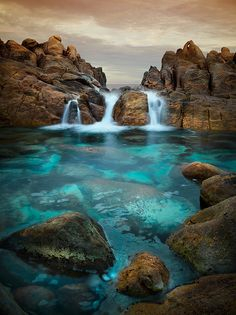Waterfalls at Wyadup Rocks - Margaret River Region, Western Australia by Christian Fletcher.Tidal Waterfalls at Wyadup Rocks - Margaret River Region, Western Australia by Christian Fletcher.