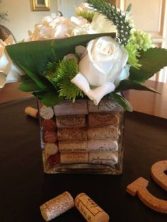 Simple flower arrangement with corks in vase for wine themed couples shower