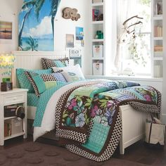 Love the beach/surf decor! Not crazy about the bedspread. But I love the furniture :)