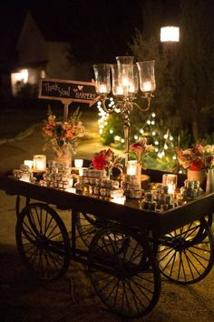 Wedding favors display on a cart - don't know where to find this cart but I am obsessed!
