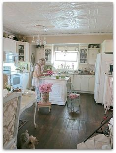 Love the tin ceiling in this shabby chic kitchen