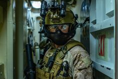 A Force Reconnaissance Marine with the Marine Expeditionary Unit's Maritime Raid Force holds rear security during Visit, Board, Search and Seizure training in Pearl Harbor, Hawaii. Marsoc Marines, Us Marines, Special Operations Command, Military Branches, Navy Sailor, Army Soldier, American Soldiers, Pearl Harbor, Coast Guard