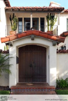 exterior by Kevin Rugee    tile step and plants by window