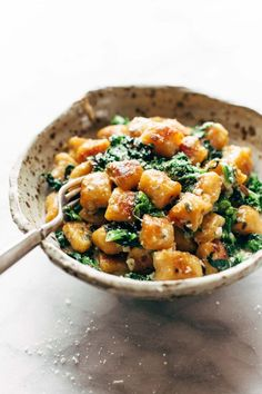 Sweet Potato Gnocchi! The easiest and best way to make Sweet Potato Gnocchi! Serve it with broccoli rabe and garlic sage butter sauce for a BOMB meal. #vegetarian #recipe #dinner #easyrecipe #yummy | pinchofyum.com