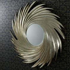 Sandringham-mirror. Circular mirror with a decorative wooden frame, finished in silver. Dia. 114cm. £199 thru Achica.