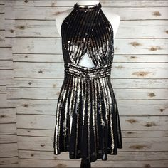 """[Free People] Sequin Stripe New Years Eve Dress 4 Dazzling, two-tone sequin stripes deck a head turning A-line minidress infused with glitzy, glam-rock attitude. A midriff cutout at the crossover bodice and an open back let you flash a little skin under the disco lights. Hidden back zip and button closure at neck.  Color: Black & Gold Fabric: 100% Viscose Size: 4 (true to size) Bust: 15"""" Waist: 14"""" Length: 35"""" Condition: NWT! No flaws.  No Trades! No PayPal! Free People Dresses Mini"""