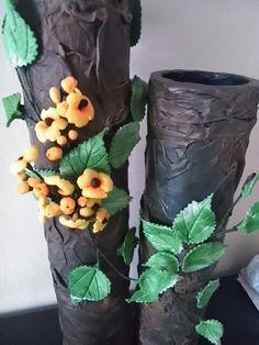 Detalle de jarrones en tubo de cartón.