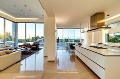 Architecture : Contemporary and astounding modern kitchen designs ideas with windows and visible from the living room picture - a part of Wonderful Modern Luxury Villas Designed By Gal Marom Architects