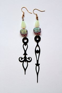 Number 60  Plum Elephants Clock Hand Earrings by mannequinreject