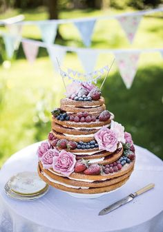 Naked Victoria Sponge wedding cake from Gillian, Linsey and Nichola Reith and their book Three Sisters Bake. Find it on Cooked.com.
