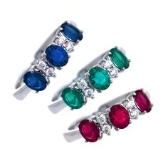 Anelli in oro bianco, zaffiri blu, smeraldi, rubini e diamanti. Rings in white gold with blue sapphires ,emeralds,rubies and diamonds