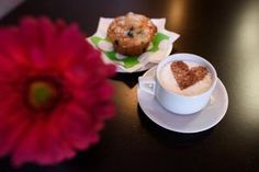 A cappuccino and a blueberry muffin are among the treats at First Date Coffee House on Hay Street./Staff photo by Andrew Craft