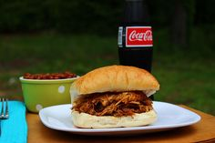 Big Bears Wife: BBQ Pulled Pork  Served w/rolls and Cole slaw