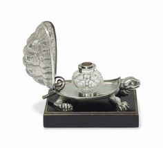 A VICTORIAN SILVER NOVELTY INKWELL IN THE FORM OF A TORTOISE MARK OF WILLIAM SUMMERS, LONDON, 1865.