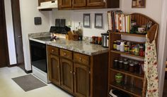 Completed budget kitchen remodel with refinished countertops and new hardware.