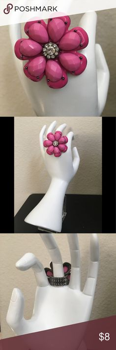 """Fashion pink daisy ring with clear rhinestones Large flower ring in hot pink color. I n the center has sparkling clear rhinestones. Measures 2"""" inches in diameter. Expandable elasticize back for great comfort. Jewelry Rings"""