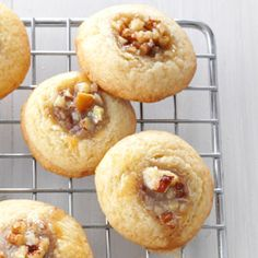 Pecan Pie Thumbprints Pecan Pie Thumbprints Recipe -A good buttery dough and nutty filling take time to make, but the results are so worth it. After munching on a few, I think you'll agree.— Peggy Key, Grant, Alabama Fall Cookie Recipes, Cookie Desserts, Just Desserts, Delicious Desserts, Dessert Recipes, Pecan Recipes, Pecan Desserts, Pecan Pies, Fall Desserts