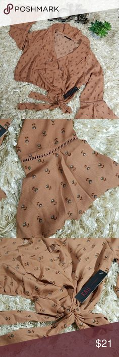 """KAII Peasant Ruffle Shirt Beautiful and light shirt with small wildflowers Color is a rose brown 100% polyester  Front snap closure Loose elastic waist with tie Chest (arm to arm) 22"""" Shoulder to bottom 17.5"""" Sleeve 23"""" Kaii Tops Blouses"""