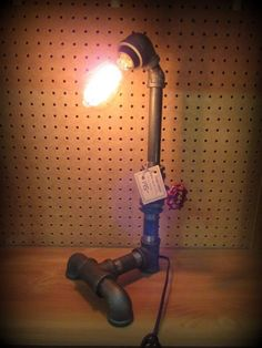 Awesome industrial look lamp. Tesla Lamps from Vendor 464 in booth 27. Priced at $145.00 Aircraft parts desk lamp from Vendor 314 in booth 38. Priced at $299.00. ~ The Brass Armadillo Antique Mall in Denver, CO ~