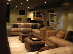 This is close to what I'm wanting! Bigger couches an make a huge leather tufted ottoman for the middle!