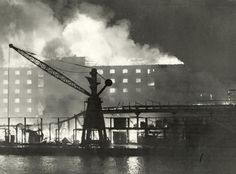 Surrey Docks burns during the Blitz. Image ©London Fire Brigade / Mary Evans Picture Library