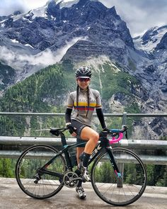 Mountains Everywhere as she bikes to dare. c5o