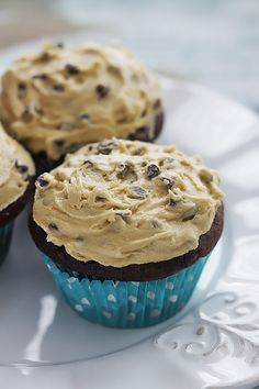 Hey guys it's Tiffany from Creme de la Crumb sharing a very special recipe today for a very special occasion…. It's Alyssa's birthday!! So not only are we celebrating with cupcakes, but we are celebrating with super moist and fluffy chocolate cupcakes topped with none other than the most amazing cream cheese chocolate chip cookie …