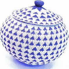 Zulu telephone-wire weaving evolved from traditional hand woven grass beer pot covers (tzinkamba). In the 1950s, weavers innovated the disc-like shapes by making baskets from telephone wire instead of grass.