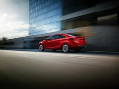 2014 Hyundai Elantra Coupe in Red (Driving)