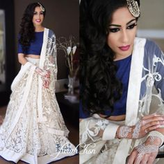 Our beautiful bride Gina in her white on white resham work engagement lehenga! This gorgeous piece is paired with a midnight blue dupion silk blouse ✨   #allthingsbridal #indianfashion #wedding #bride #style #fashion #designer