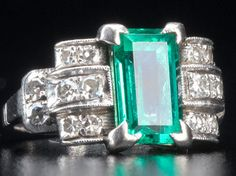 Art Deco Columbian emerald and diamond pt. ring. Clear baguette-cut emerald, approx. 1.75 cts., flanked by curved rows of circular-cut diamonds, approx. .30 ct. TW.
