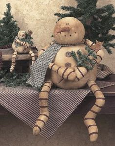 Primitive sitting snowman <3