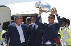 Ronaldo can't hide his delight as he emerges from the Portugal plane after it landed in the capital city of Lisbon on Monday