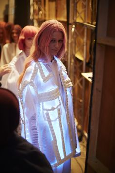 Xiao Li #LFW AW14 unknown source- really different and innovative- light display under the knitwear and the mesh!