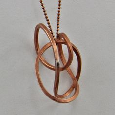 This Handmade Copper Wire Free Form 22 Inch Long Metal Beaded Necklace Oscarcrow is a pathway necklace. The form is like a moibius strip. A 12 gauge