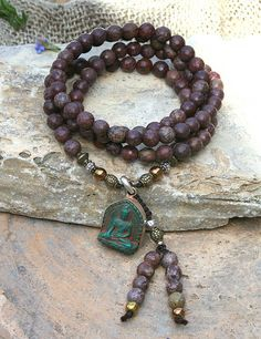Mala made of 108, about 7.8 mm - 0.31 inch, beautiful faceted rhyolite gemstones and decorated with faceted rhyolite, hematite and a Nepalese Buddha pendant - look4treasures on Etsy