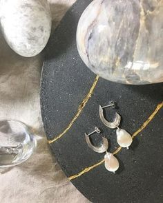 Taking the rough metal of silver silver earrings with the classic appeal of pearls, these pieces find perfect harmony. Statement Earrings, Silver Earrings, Drop Earrings, Irish Jewelry, Minimal Jewelry, Initial Necklace, Jewelry Branding, Initials, Jewelry Design