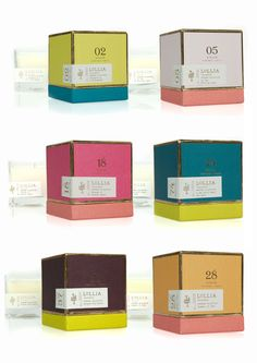 "Lollia Poetic Candles  Lovely packaging and use of color for Lollia's new line of Poetic License candles, given equally lovely names like ""Stacks of Pretty Paper"" and ""Running in Grass Barefoot."""