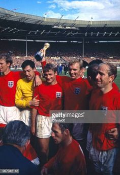 Captain Bobby Moore of England holds the Jules Rimet trophy aloft alonside tea mates after the World Cup Final between England and West Germany at Wembley Stadium on July 1966 in London, England. Get premium, high resolution news photos at Getty Images English Football Teams, Football Icon, National Football Teams, World Football, Sport Football, British Football, Retro Football, Vintage Football, Football Kits