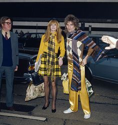 Fashionable inspirations: Rod Stewart  British rock singer Rod Stewart and model Dee Harrington sport co-ordinating outfits at London Airport, 24th January 1974