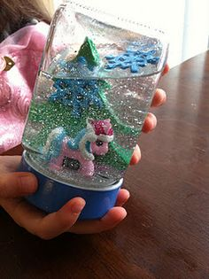 homemade snow globes- baby oil, glitter, jar, stuff to make a scene