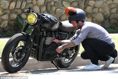 On your bike! David Beckham was seen checking out his motorcycle during a ride through the...