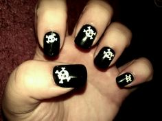 One set of my new Halloween nails....the skull an cross bones glow in the dark :D of course I had to get them lol if ya like them then check out wal mart, be sure to get glue cuz they dnt come with it...