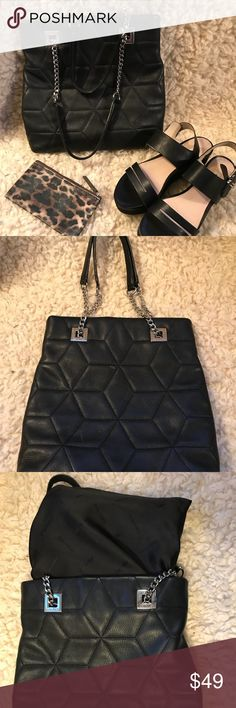Calvin Klein quilted leather tote silver hardware Great used condition  2 small marks in front of bag (see pics) Lining is clean Thanks for looking and please check out the rest of my closet. Calvin Klein Bags
