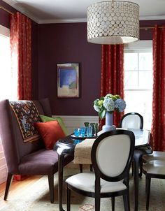 A dark, dramatic dining room sets the tone for entertaining or nestling in for a quiet dinner at home. Some purples (dark plum-like ones or dusty gray-ish ones) can be perfect for the dining room, whether it's filled with a loud and lively party or just two at the table.
