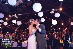 Loved the lanterns over the dance floor at this Happy Days Lodge winter wedding