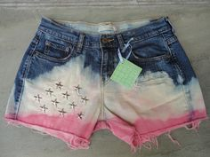 Hand upcycled jeans shorts by 16-year old designer, Sophia Scanlan.  Tye die red, white and blue with star studs.