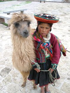 A Quechua girl with her llama in Bolivia.